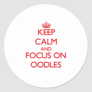 Keep Calm and focus on Oodles Stickers