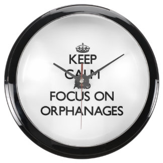 Keep Calm and focus on Orphanages Fish Tank Clocks