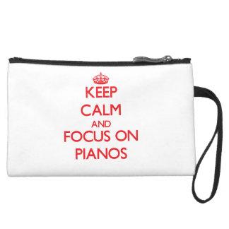 Keep Calm and focus on Pianos Wristlet Purse