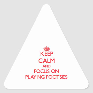 Keep Calm and focus on Playing Footsies Triangle Stickers