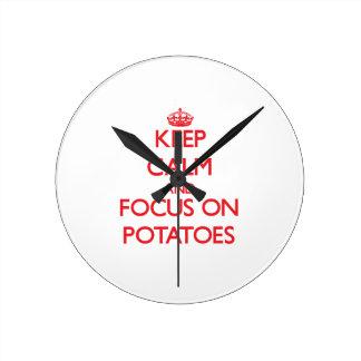 Keep Calm and focus on Potatoes Wallclocks
