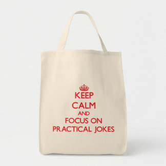 Keep Calm and focus on Practical Jokes Tote Bags