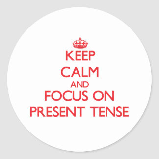 Keep Calm and focus on Present Tense Classic Round Sticker