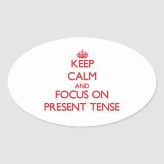 Keep Calm and focus on Present Tense Oval Sticker