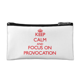 Keep Calm and focus on Provocation Cosmetic Bags