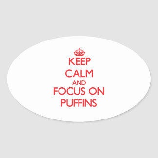 Keep calm and focus on Puffins Oval Stickers