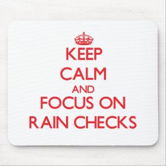 Keep Calm and focus on Rain Checks Mouse Pads