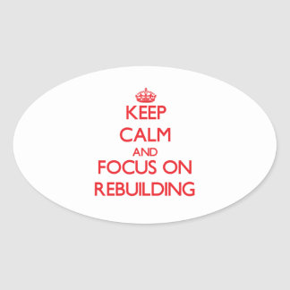 Keep Calm and focus on Rebuilding Oval Stickers