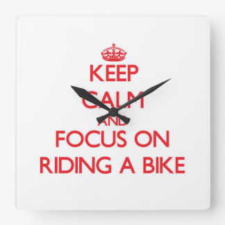 Keep Calm and focus on Riding A Bike Wall Clock
