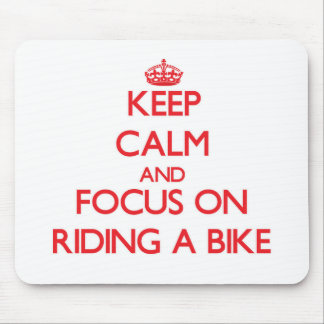 Keep Calm and focus on Riding A Bike Mouse Pads