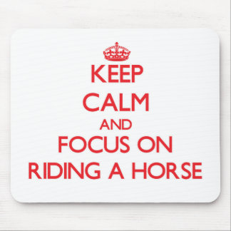 Keep Calm and focus on Riding A Horse Mouse Pads