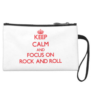 Keep Calm and focus on Rock And Roll Wristlet Clutch