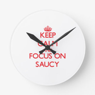 Keep Calm and focus on Saucy Round Wall Clock