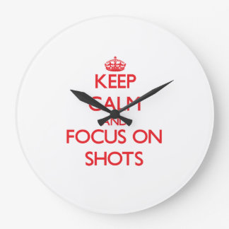 Keep Calm and focus on Shots Wall Clock