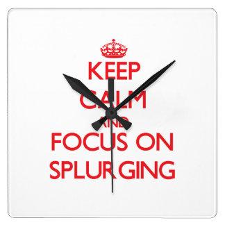 Keep Calm and focus on Splurging Square Wallclocks