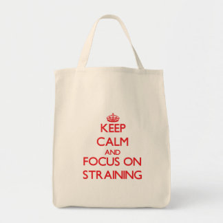 Keep Calm and focus on Straining Tote Bags