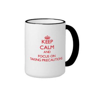 Keep Calm and focus on Taking Precautions Ringer Coffee Mug