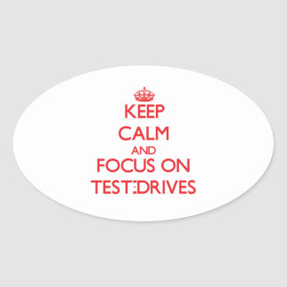 Keep Calm and focus on Test-Drives Oval Stickers