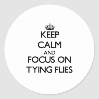Keep Calm and focus on Tying Flies Round Stickers