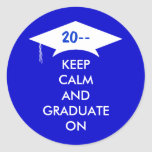 Keep calm and graduate in royal blue and white classic round sticker