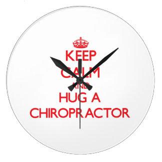 Keep Calm and Hug a Chiropractor Wallclocks