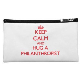 Keep Calm and Hug a Philanthropist Makeup Bags