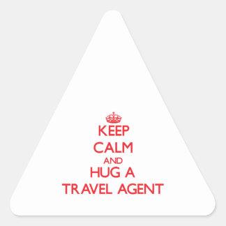 Keep Calm and Hug a Travel Agent Triangle Sticker