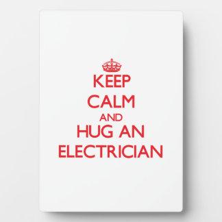 Keep Calm and Hug an Electrician Plaques