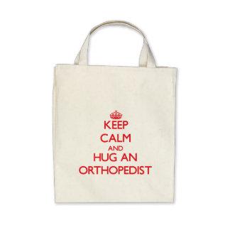 Keep Calm and Hug an Orthopedist Tote Bags