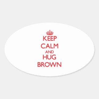 Keep calm and Hug Brown Oval Sticker