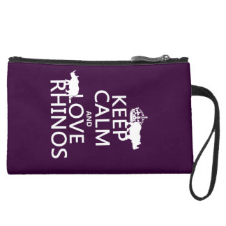 Keep Calm and Love Rhinos (any background color) Suede Wristlet