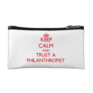 Keep Calm and Trust a Philanthropist Cosmetics Bags