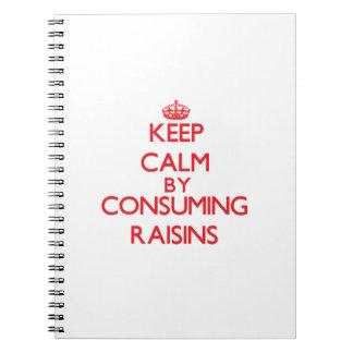 Keep calm by consuming Raisins Spiral Notebooks