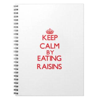 Keep calm by eating Raisins Spiral Notebooks