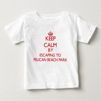 Keep calm by escaping to Pelican Beach Park Florid Tee Shirts
