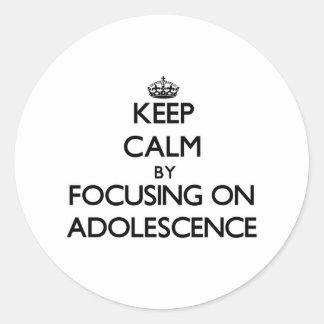 Keep Calm by focusing on Adolescence Round Sticker