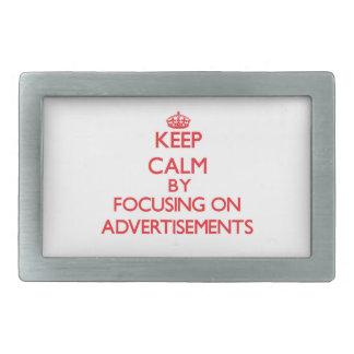Keep Calm by focusing on Advertisements Rectangular Belt Buckle
