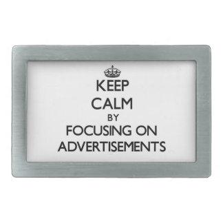 Keep Calm by focusing on Advertisements Belt Buckles
