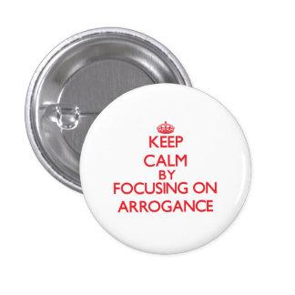 Keep Calm by focusing on Arrogance Pinback Button