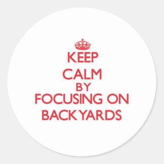 Keep Calm by focusing on Backyards Sticker