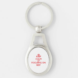 Keep Calm by focusing on Beef Silver-Colored Oval Metal Keychain
