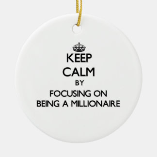 Keep Calm by focusing on Being A Millionaire Ornaments