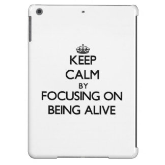 Keep Calm by focusing on Being Alive iPad Air Cases