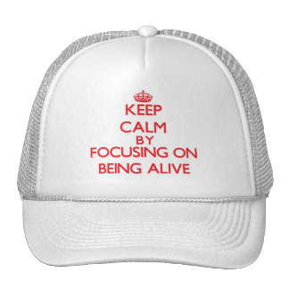 Keep Calm by focusing on Being Alive Trucker Hats
