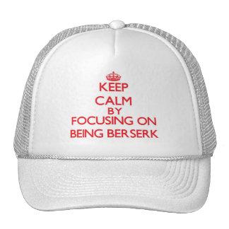 Keep Calm by focusing on Being Berserk Trucker Hat