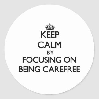 Keep Calm by focusing on Being Carefree Round Stickers
