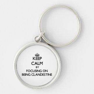 Keep Calm by focusing on Being Clandestine Keychains