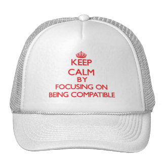 Keep Calm by focusing on Being Compatible Trucker Hat