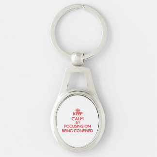 Keep Calm by focusing on Being Confined Silver-Colored Oval Metal Keychain