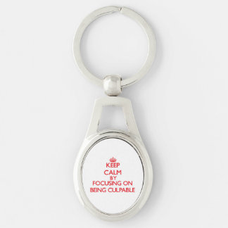 Keep Calm by focusing on Being Culpable Silver-Colored Oval Metal Keychain